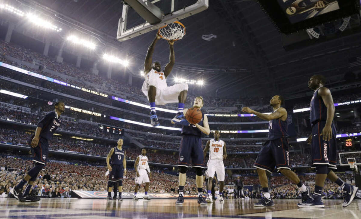 Florida center Patric Young dunks against Connecticut during the second half of the NCAA Final Four tournament college basketball semifinal game Saturday, April 5, 2014, in Arlington, Texas. (AP Photo/David J. Phillip)