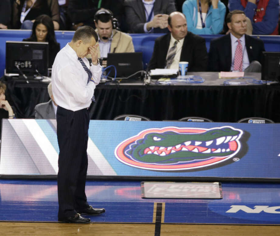 Florida head coach Billy Donovan reacts during the second half of an NCAA Final Four tournament college basketball semifinal game against Connecticut Saturday, April 5, 2014, in Arlington, Texas. Connecticut won 63-53. (AP Photo/Tony Gutierrez)
