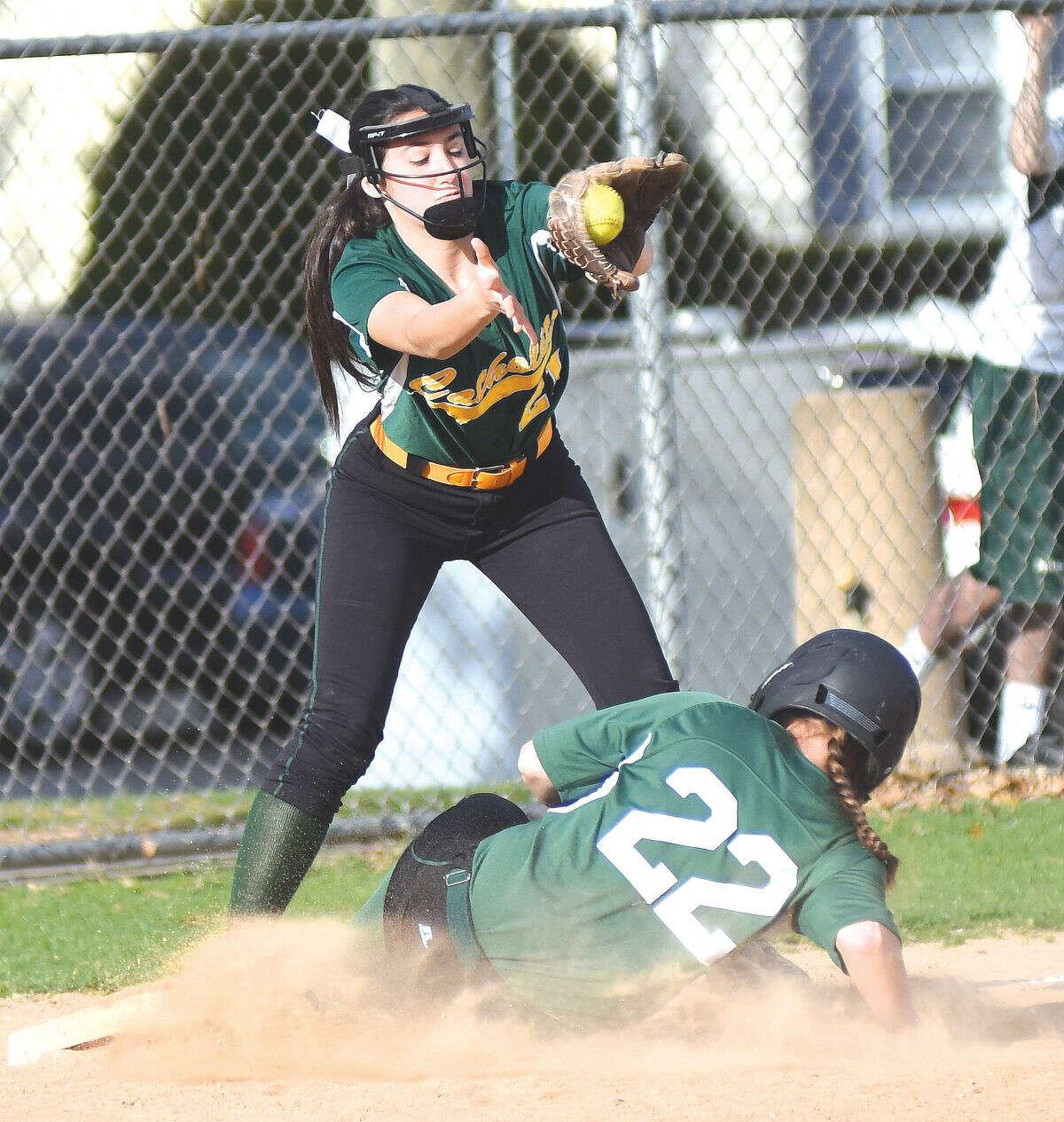 Norwalk's Katie Sciglimpaglia slides into third base against Trinity Catholic on Wednesday. (John Nash/Hour photo)