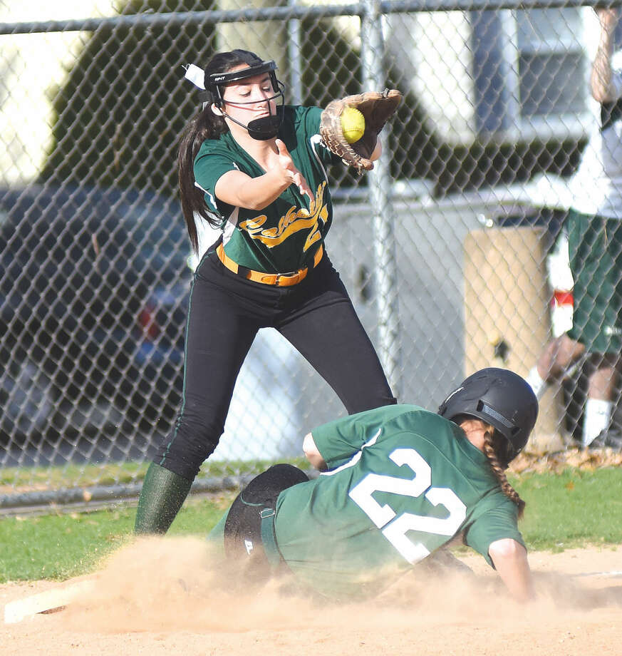Norwalk's Katie Sciglimpaglia slides into third base against Trinity Catholic on Wednesday. (John Nash/Hour photo)
