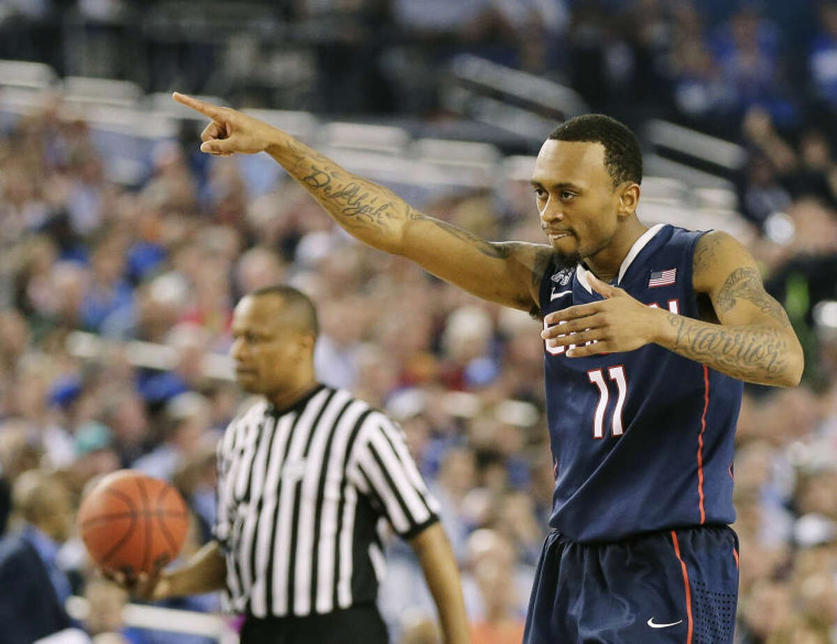 Connecticut guard Ryan Boatright (11) celebrates as he walks down court against Florida during the second half of the NCAA Final Four tournament college basketball semifinal game Saturday, April 5, 2014, in Arlington, Texas. (AP Photo/Eric Gay)
