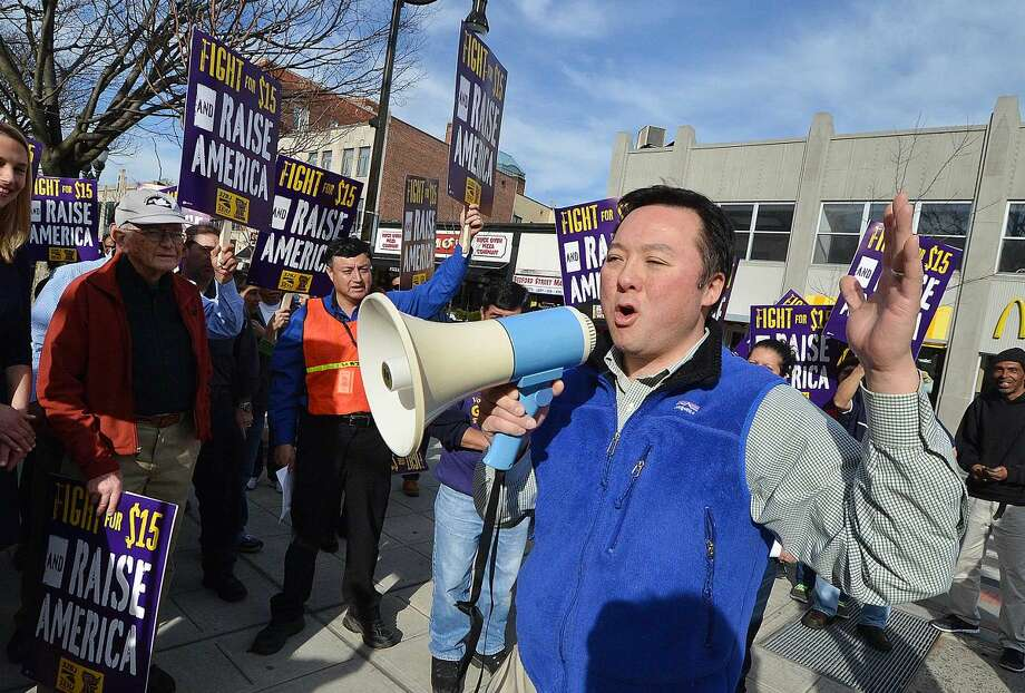 Hour Photo/Alex von Kleydorff State Rep. William tong 147th dist. joins janitors in downtown Stamford to rally for higher wages and to echo the global wave of protests against wage inequality that has been called the 'Fight for $15'. Members of 32BJ Union in Stamford march as workers across the country mobilize against income inequality.