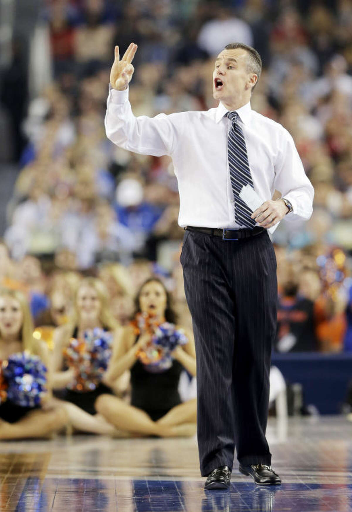 Florida head coach Billy Donovan gestures to the team during the second half of the NCAA Final Four tournament college basketball semifinal game against Connecticut Saturday, April 5, 2014, in Arlington, Texas. (AP Photo/Eric Gay)