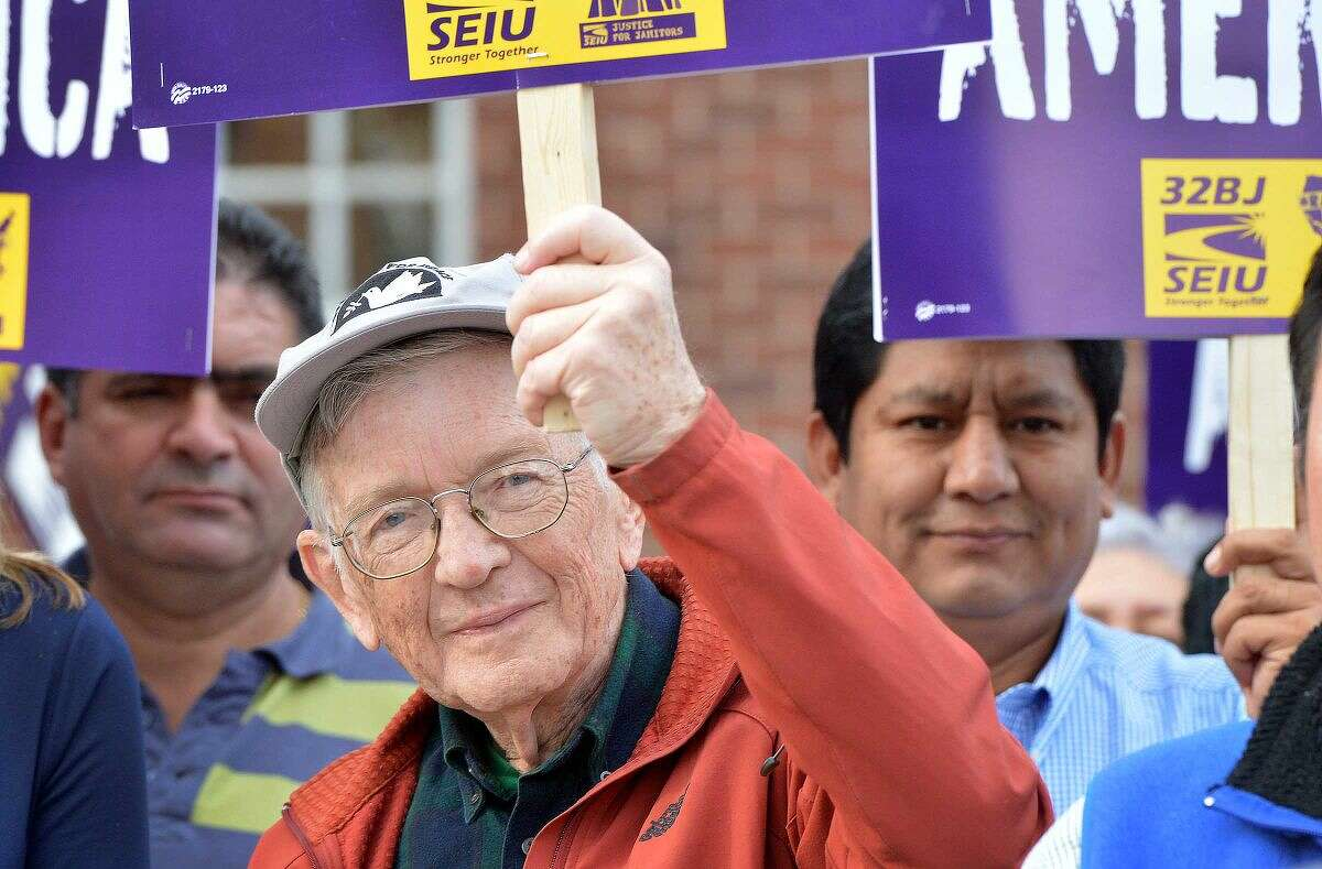 Hour Photo/Alex von Kleydorff Former Mayor Bill Collins takes part as workers unite in downtown Stamford to rally for higher wages and to echo the global wave of protests against wage inequality that has been called the 'Fight for $15'. Members of 32BJ Union in Stamford march as workers across the country mobilize against income inequality.