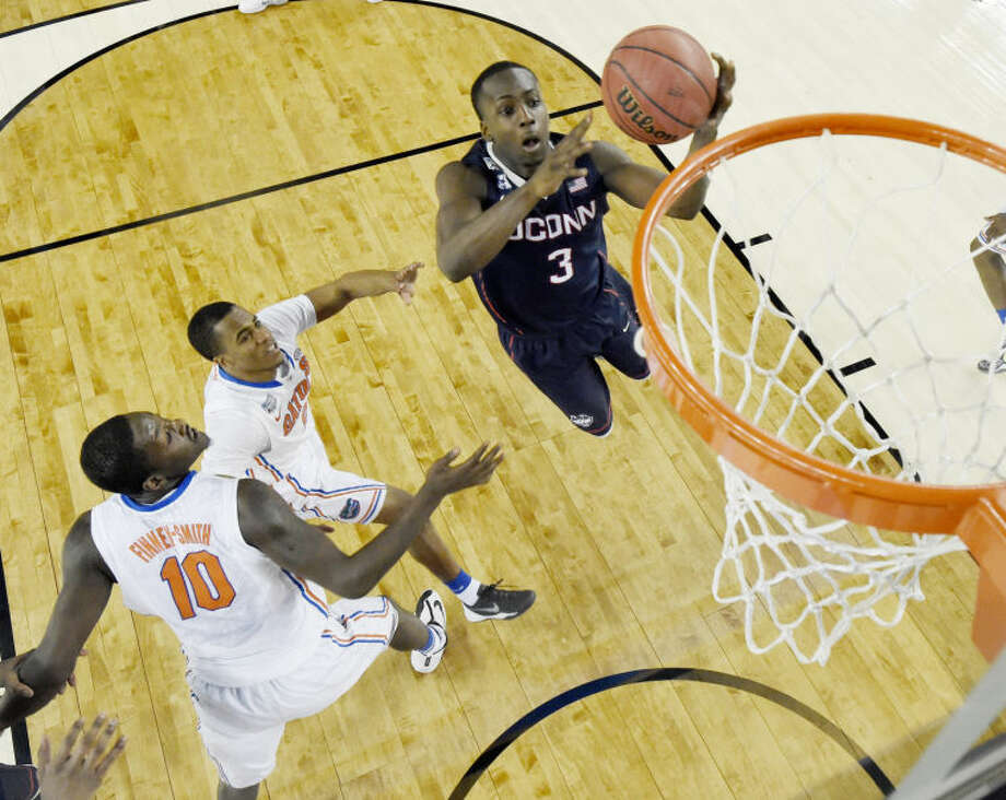 Connecticut guard Terrence Samuel (3) shoots against Florida during the second half of the NCAA Final Four tournament college basketball semifinal game Saturday, April 5, 2014, in Arlington, Texas. (AP Photo/Chris Steppig, pool)