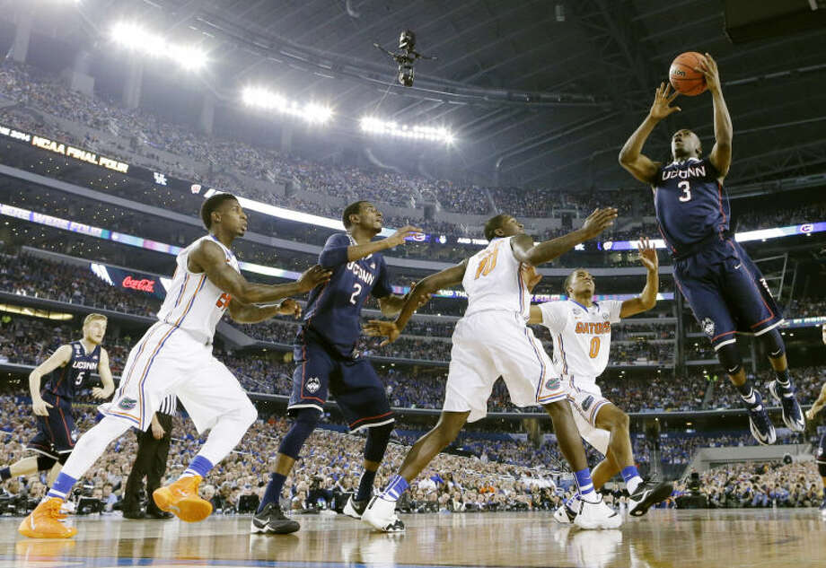 Connecticut guard Terrence Samuel (3) shoots against Florida during the second half of the NCAA Final Four tournament college basketball semifinal game Saturday, April 5, 2014, in Arlington, Texas. (AP Photo/Eric Gay)