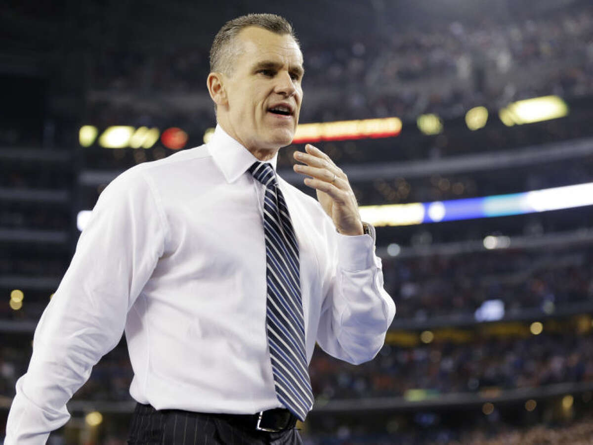 Florida head coach Billy Donovan leaves the floor after his team lost to Connecticut at their NCAA Final Four tournament college basketball semifinal game Saturday, April 5, 2014, in Arlington, Texas. Connecticut won 63-53. (AP Photo/Eric Gay)