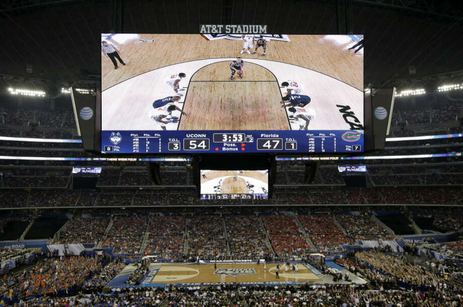 Connecticut guard Shabazz Napier takes a foul shot against Florida during the second half of the NCAA Final Four tournament college basketball semifinal game Saturday, April 5, 2014, in Arlington, Texas. Connecticut won 63-53. (AP Photo/Tony Gutierrez)