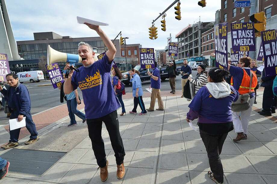 Hour Photo/Alex von Kleydorff Workers unite in downtown Stamford to rally for higher wages and to echo the global wave of protests against wage inequality that has been called the 'Fight for $15'. Members of 32BJ Union in Stamford march as workers across the country mobilize against income inequality.