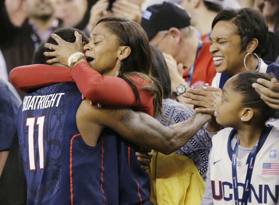 ADDS NAME OF PERSON HUGGING BOATRIGHT - Connecticut guard Ryan Boatright (11) gets a hug from his mother, Tanesha Boatright, after his team defeated Florida 63-53 in an NCAA men's college basketball tournament Final Four semifinal, Saturday, April 5, 2014, in Arlington, Texas. (AP Photo/Eric Gay)