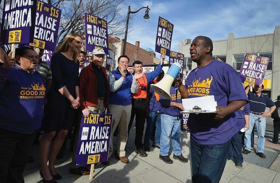 Hour Photo/Alex von Kleydorff Alberto Bernandez speaks to the crowd in downtown Stamford to rally for higher wages and to echo the global wave of protests against wage inequality that has been called the 'Fight for $15'. Members of 32BJ Union in Stamford march as workers across the country mobilize against income inequality.