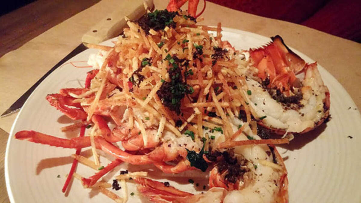 Photo by Frank Whitman Roasted lobster with black truffle and shoestring fries.