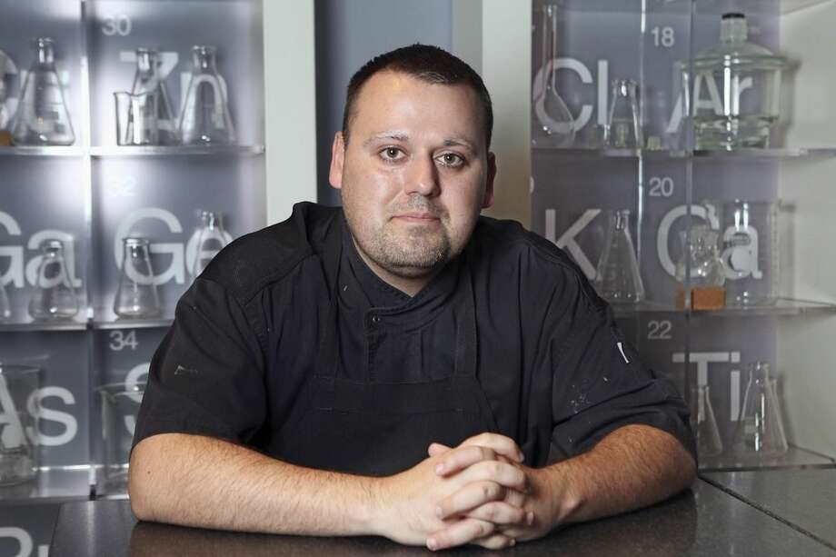 In this Nov. 7, 2013 photo Chef Homaro Cantu poses for a photo at his restaurant Moto in Chicago. Authorities say Cantu was found dead in Chicago, Tuesday, April 14, 2015, in a building where he had planned to open a brewery. The Cook County medical examiner's office confirmed the death but did not release a cause. (Chandler West/Sun-Times Media via AP)