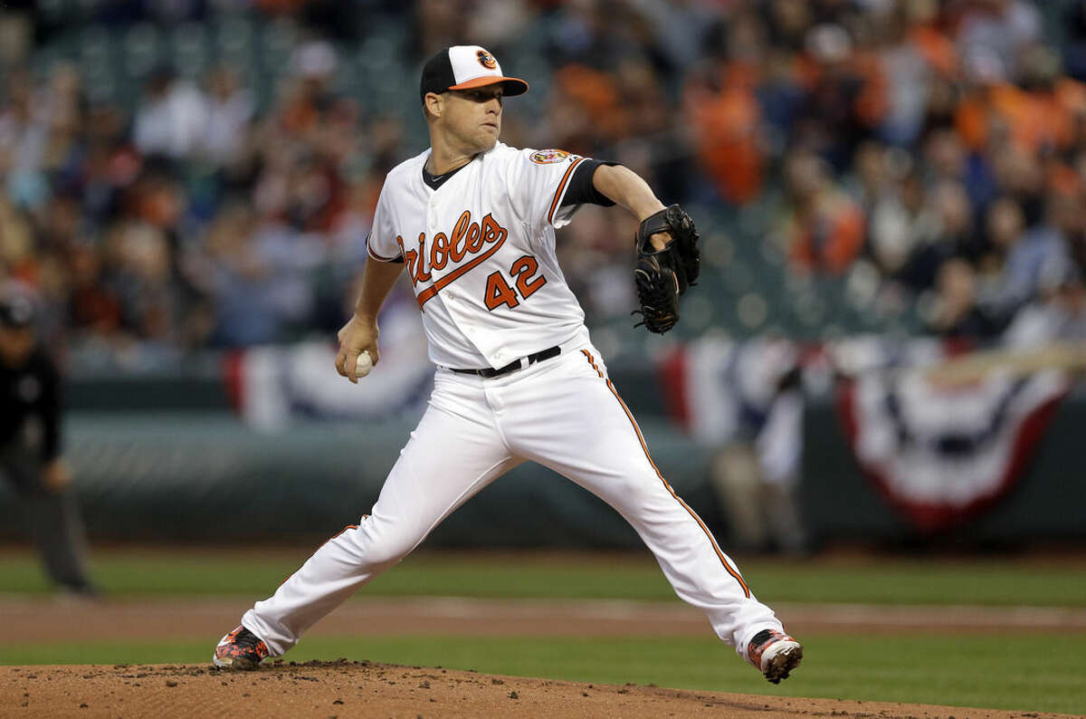 Baltimore Orioles starting pitcher Bud Norris throws to the New York Yankees in the first inning of a baseball game, Wednesday, April 15, 2015, in Baltimore. (AP Photo/Patrick Semansky)