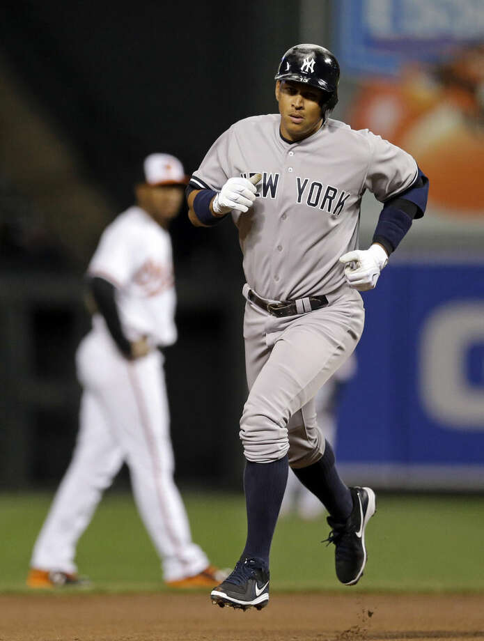 New York Yankees' Alex Rodriguez rounds the bases after hitting a solo home run in the fourth inning of a baseball game against the Baltimore Orioles, Wednesday, April 15, 2015, in Baltimore. (AP Photo/Patrick Semansky)