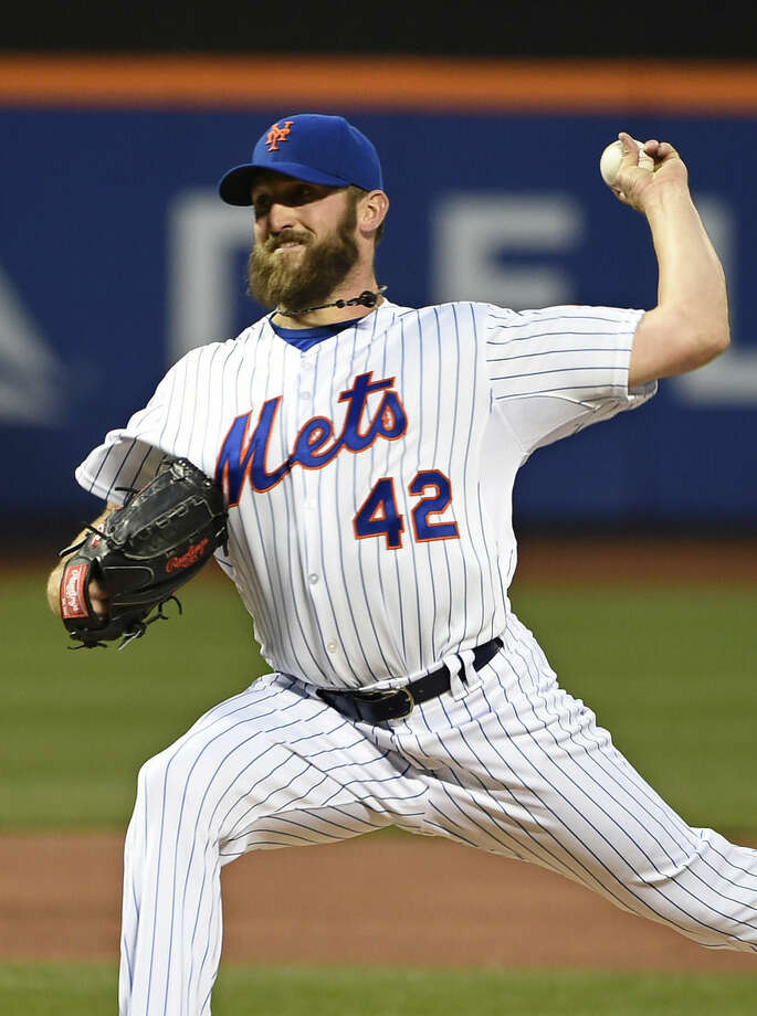 New York Mets starter Jonathon Niese pitches in the second inning of a baseball game against the Philadelphia Phillies at Citi Field on Wednesday, April 15, 2014, in New York. (AP Photo/Kathy Kmonicek)