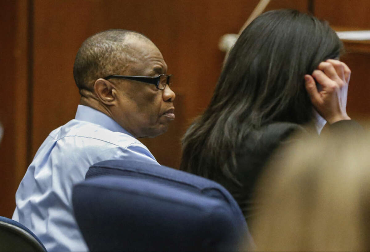 """Lonnie Franklin Jr., left, appears in Los Angeles Superior Court for opening statements in his trial on Tuesday, Feb. 16, 2016, in Los Angeles. Franklin has pleaded not guilty to killing nine women and a 15-year-old girl between 1985 and 2007 in one of the city's most notorious serial killer cases. The """"Grim Sleeper"""" nickname was coined because of an apparent 14-year gap in the murders between 1988 and 2002. (Al Seib/Los Angeles Times via AP, Pool)"""