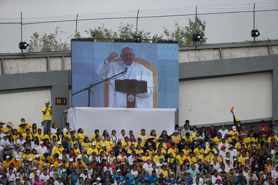 Pope Francis is seen on a big screen as he addresses Mexican youth at Jose Maria Morelos y Pavon Stadium in Morelia, Mexico, Tuesday, Feb. 16, 2016. On his one-day trip to the capital of the Michoacan state, Francis also celebrated Mass and visited the Morelia cathedral. (AP Photo/Rebecca Blackwell)