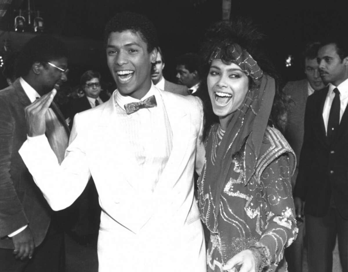 """FILE - In this March 22, 1985 file photo, actor Taimak, left, and Vanity arrive at the Century Plitt Theater for the premiere of their film """"The Last Dragon,"""" in Los Angeles. Vanity, a Prince protege who renounced her sexy stage persona to become a Christian minister, has died at age 57. The singer and actress, born Denise Matthews, died Monday, Feb. 15, 2016, at a hospital in Fremont, Calif, said Gisela Hernandez, a spokeswoman for Washington Hospital Health Care System. (AP Photo/Liu Heung Shing, File)"""