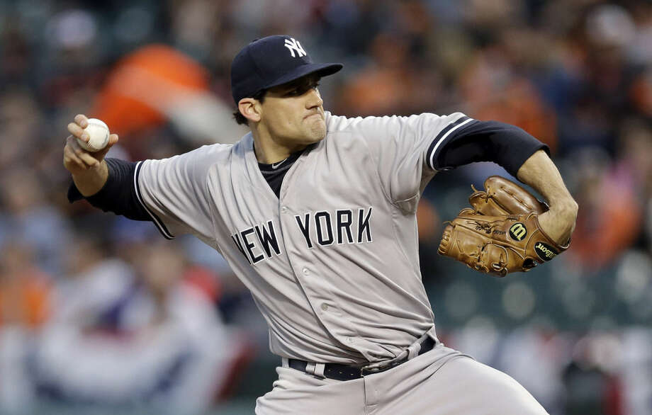 New York Yankees starting pitcher Nathan Eovaldi throws to the Baltimore Orioles in the first inning of a baseball game, Wednesday, April 15, 2015, in Baltimore. (AP Photo/Patrick Semansky)