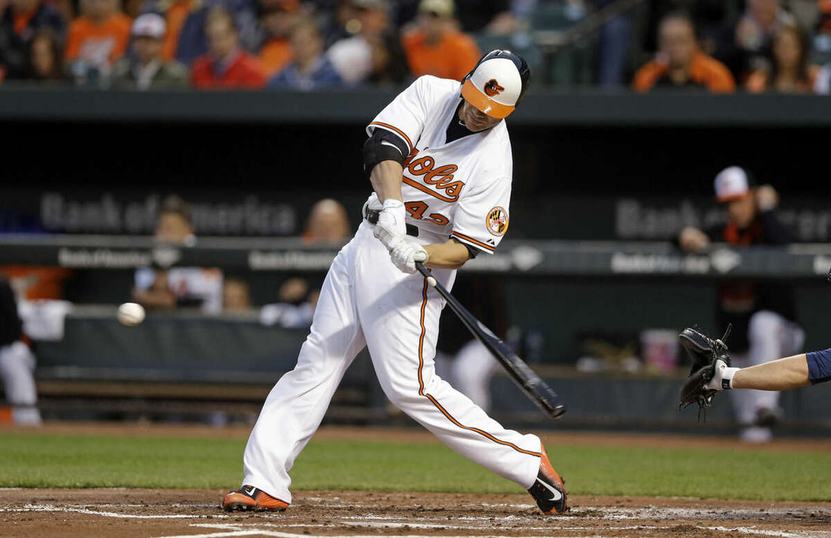 Baltimore Orioles' Chris Davis singles in the first inning of a baseball game against the New York Yankees, Wednesday, April 15, 2015, in Baltimore. Everth Cabrera scored on the play. (AP Photo/Patrick Semansky)