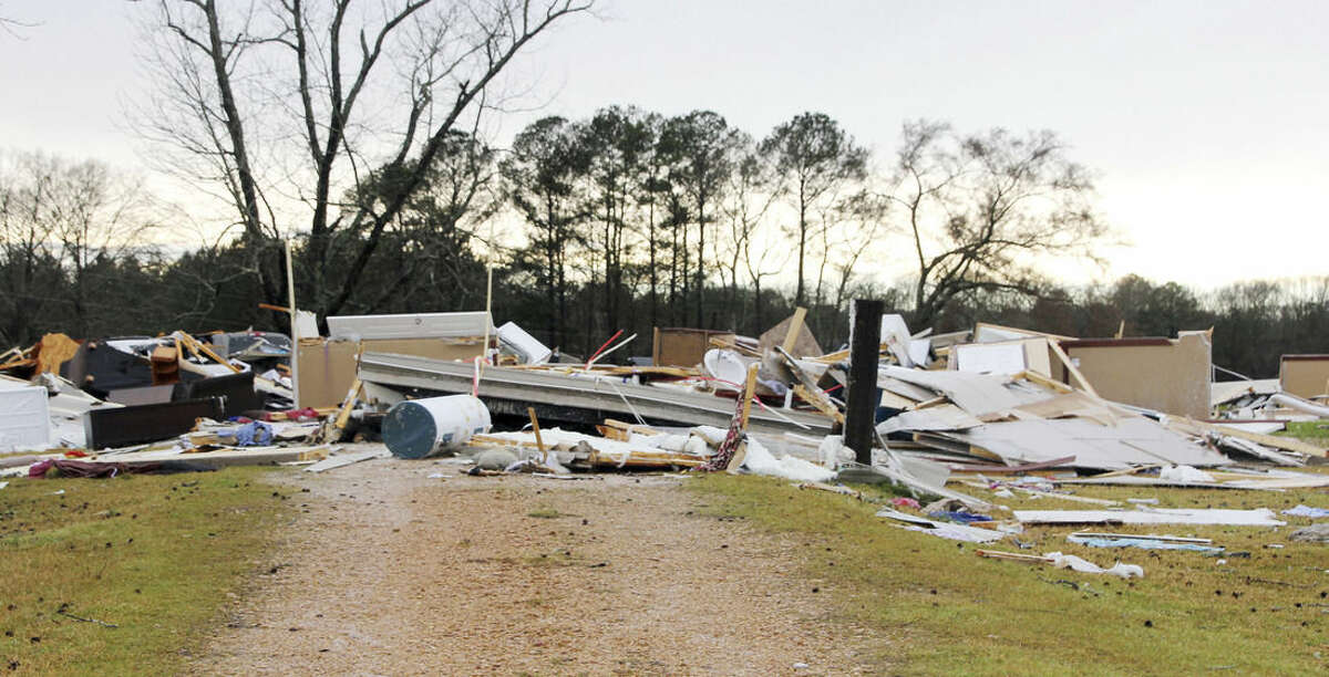 This mobile home which also served as a day care facility in rural Lincoln County, Miss., is believed to have been destroyed by a possible tornado, Monday, Feb. 15, 2016, as severe weather affected south Mississippi. Minor injuries were reported to the adults and children inside. Officials are investigating reports of at least two possible tornadoes that accompanied a line of thunderstorms across central and southern Mississippi Monday. (The Daily Leader, via AP)
