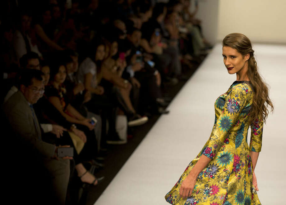 A model displays a creation by Mexican fashion house Pineda Covalin during a runway show at Mercedes-Benz Fashion Week in Mexico City, Tuesday, April 14, 2015. (AP Photo/Rebecca Blackwell)