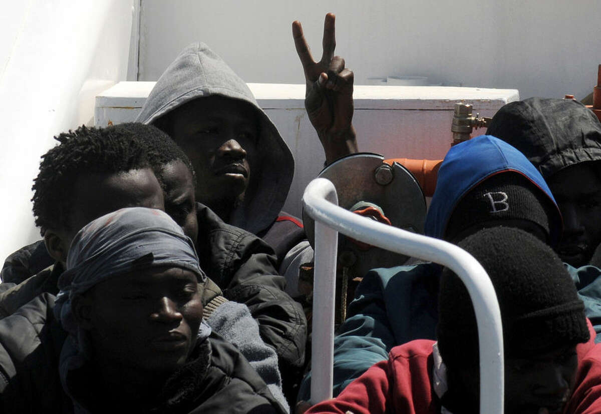 Migrants arrive at Palermo's harbor, Italy, after being rescued at sea, Wednesday, April 15, 2015. The U.N. refugee agency says the shipwreck in the Mediterranean this week, in which 400 migrants are presumed to have died, is among the deadliest single incidents in the last decade. The tragedy comes amid an unprecedented wave of migration toward Europe from Africa and the Middle East. UNHCR Italy spokeswoman Barbara Molinario says 900 migrants have died or gone missing at sea so far this year, part of a phenomenon the agency has been tracking since 2011. (AP Photo/Alessandro Fucarini)