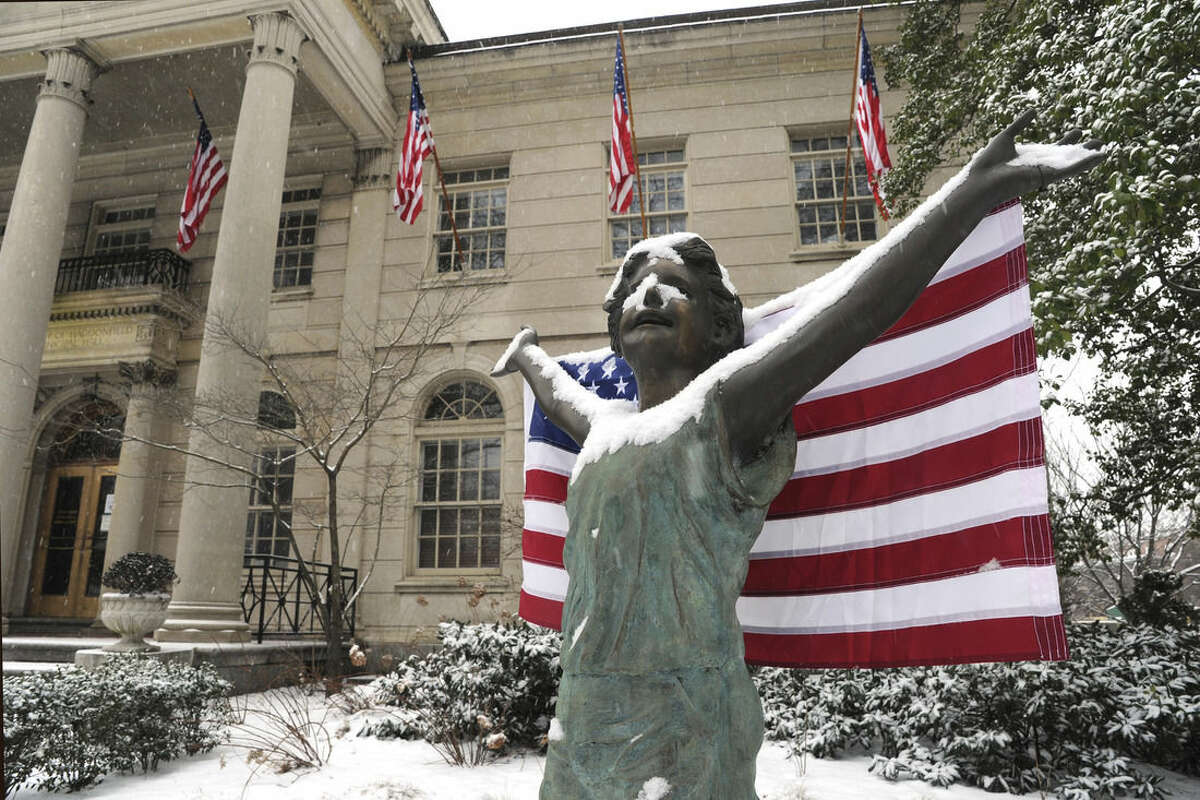 Borough Hall - and public art - is festooned with American flags for the Presidents Day holiday Monday, Feb., 15, 2016, in Haddonfield, N.J. Tom Gralish/The Philadelphia Inquirer via AP)