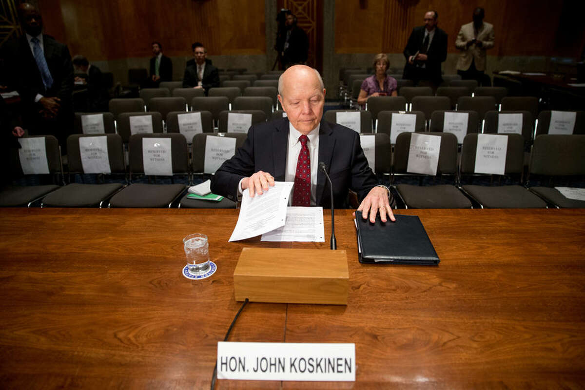 Internal Revenue Service (IRS) Commissioner John Koskinen prepares to testify on Capitol Hill in Washington, Wednesday, April 15, 2015, before the Senate Homeland Security and Governmental Affairs Committee hearing to examine IRS challenges in implementing the Affordable Care Act. (AP Photo/Andrew Harnik)