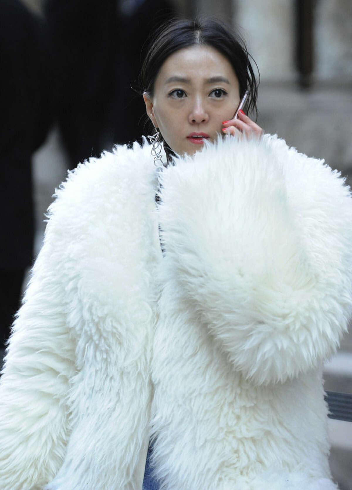 """Ji Young, of South Korea, wears a fur coat outside the Alexander Wang Fall 2016 show during Fashion Week, Saturday, Feb. 13, 2016, in New York. Bitter temperatures and biting winds had much of the northeastern United States bundling up for the some of the worst cold of the winter - a snap so bad it forced an ice festival in Central Park to cancel and caused an Interstate pileup that killed three. """"These temperatures can be life threatening - especially for seniors, infants and people with medical conditions,"""" New York City Mayor Bill de Blasio said. Stay indoors and take care of each other, he counseled. (AP Photo/Diane Bondareff)"""