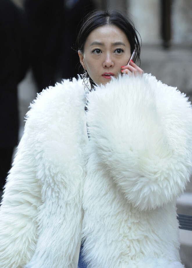 "Ji Young, of South Korea, wears a fur coat outside the Alexander Wang Fall 2016 show during Fashion Week, Saturday, Feb. 13, 2016, in New York. Bitter temperatures and biting winds had much of the northeastern United States bundling up for the some of the worst cold of the winter — a snap so bad it forced an ice festival in Central Park to cancel and caused an Interstate pileup that killed three. ""These temperatures can be life threatening — especially for seniors, infants and people with medical conditions,"" New York City Mayor Bill de Blasio said. Stay indoors and take care of each other, he counseled. (AP Photo/Diane Bondareff)"