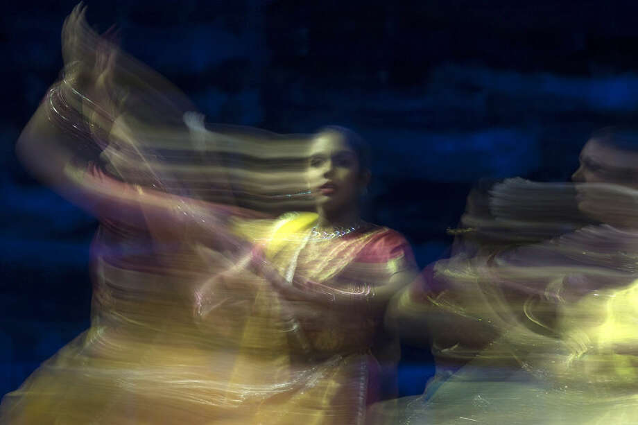 A dancer performs ahead of an event attended by Indian Prime Minister Narendra Modi and Canadian Prime Minister Stephen Harper in Toronto, Wednesday, April 15 2015. (Chris Young/The Canadian Press via AP) MANDATORY CREDIT