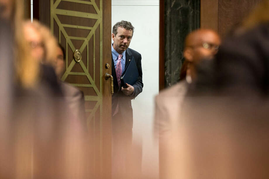 Republican Presidential candidate, Sen. Rand Paul, R-Ky., arrives on Capitol Hill in Washington, Wednesday, April 15, 2015, to testify before a Senate Judiciary Committee hearing to examine the need to reform asset forfeiture. (AP Photo/Andrew Harnik)
