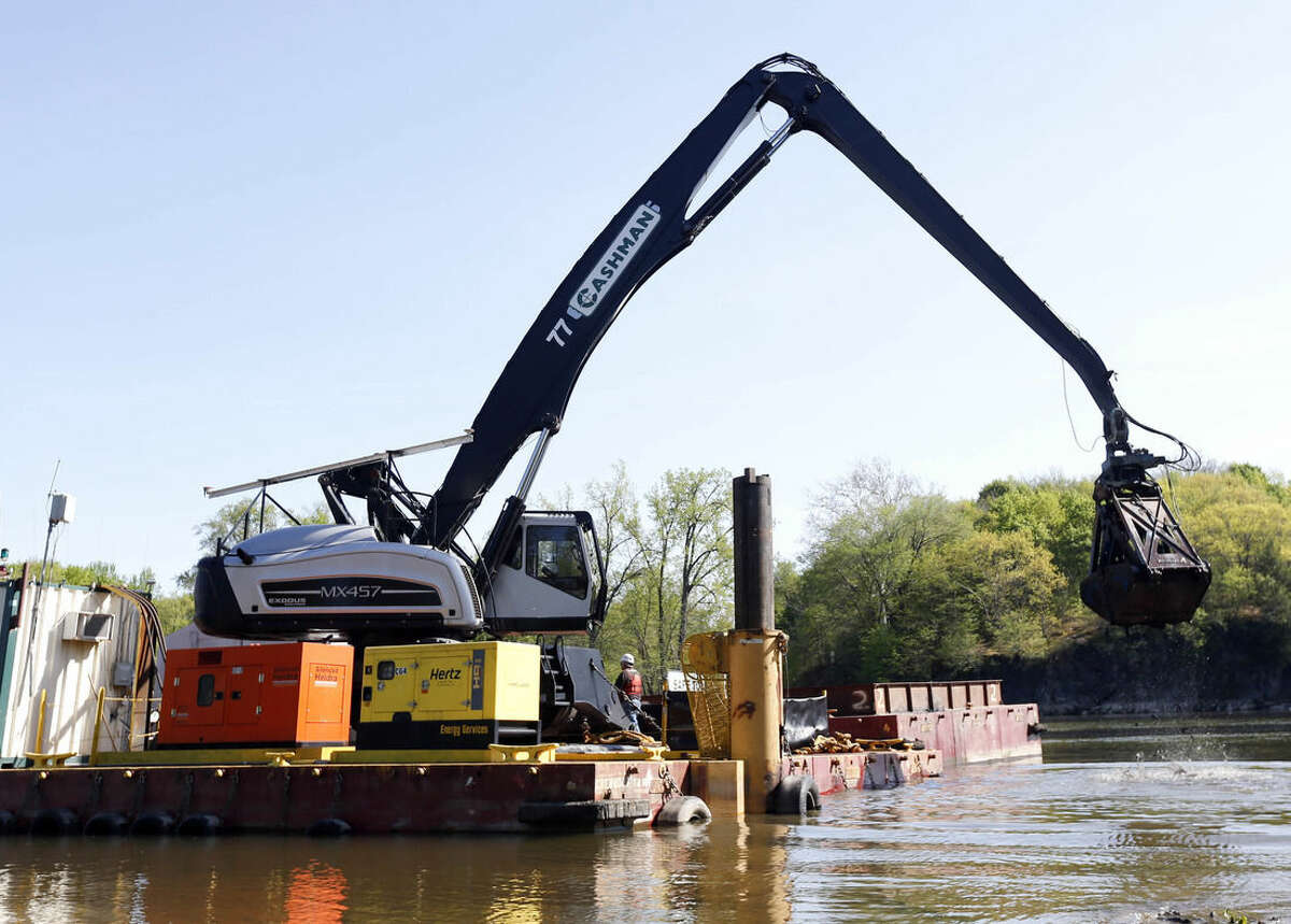 FILE - In this May 7, 2015 file photo, crews perform dredging work along the upper Hudson River in Waterford, N.Y. Dredging operations on the upper Hudson River have wound down after six years and some $1.5 billion in costs, but the push to expand the cleanup continues. (AP Photo/Mike Groll, File)