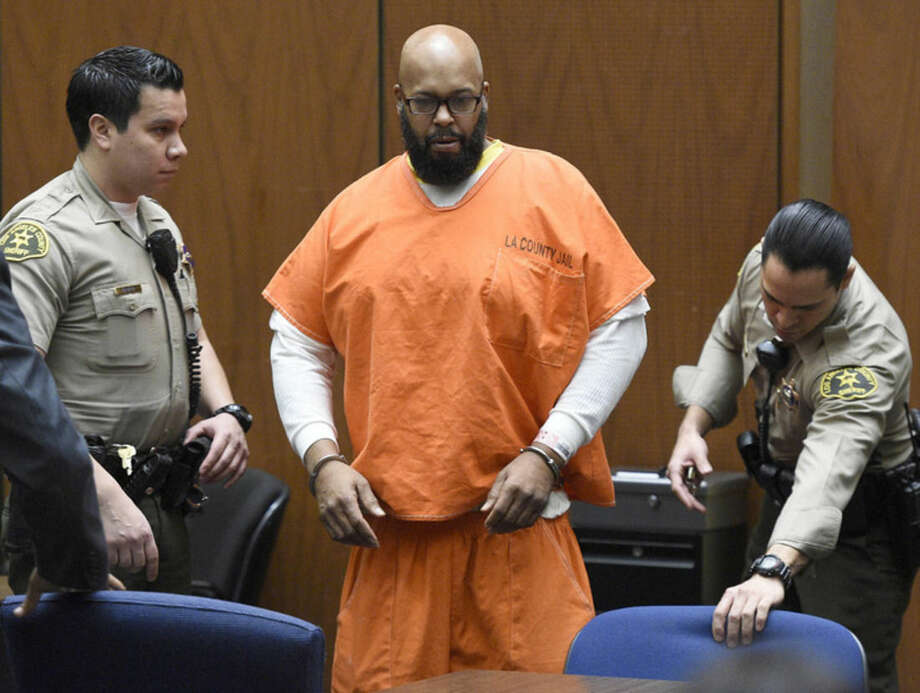 """FILE - In this March 9, 2015 file photo, Marion """"Suge"""" Knight arrives in court for a hearing about evidence in his murder case, in Los Angeles. Knight is scheduled to return to court on Thursday, April 16, 2015, for the conclusion of a preliminary hearing in which a judge determines whether there is enough evidence for the former rap music mogul to stand trial on murder, attempted murder and hit-and-run charges filed after he struck two men with his pickup truck in late January. (AP Photo/Kevork Djansezian, Pool, File)"""