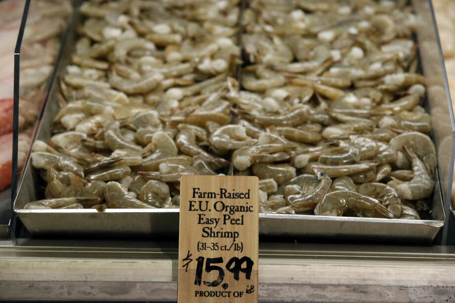 EU certified organic farm-raised easy peel shrimp are for sale on a tray at the Wegmans, Friday, April 10, 2015 in Fairfax, Va. Organic fish is certified in the EU and Canada because the US doesn't have any standard. After more than a decade of delays, the government is moving toward allowing the sale of U.S.-raised organic fish and shellfish. But don't expect it in the grocery store anytime soon. (AP Photo/Alex Brandon)