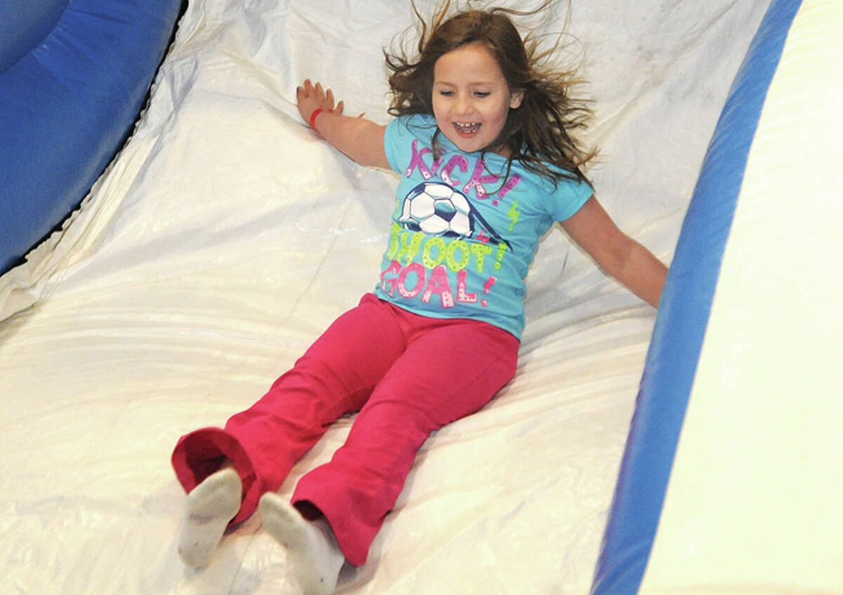 Virginia Platel 7, on the bounce about inflatable Sunday at the Kids Fest held in the Wilton High School field house. Hour photo/Matthew Vinci
