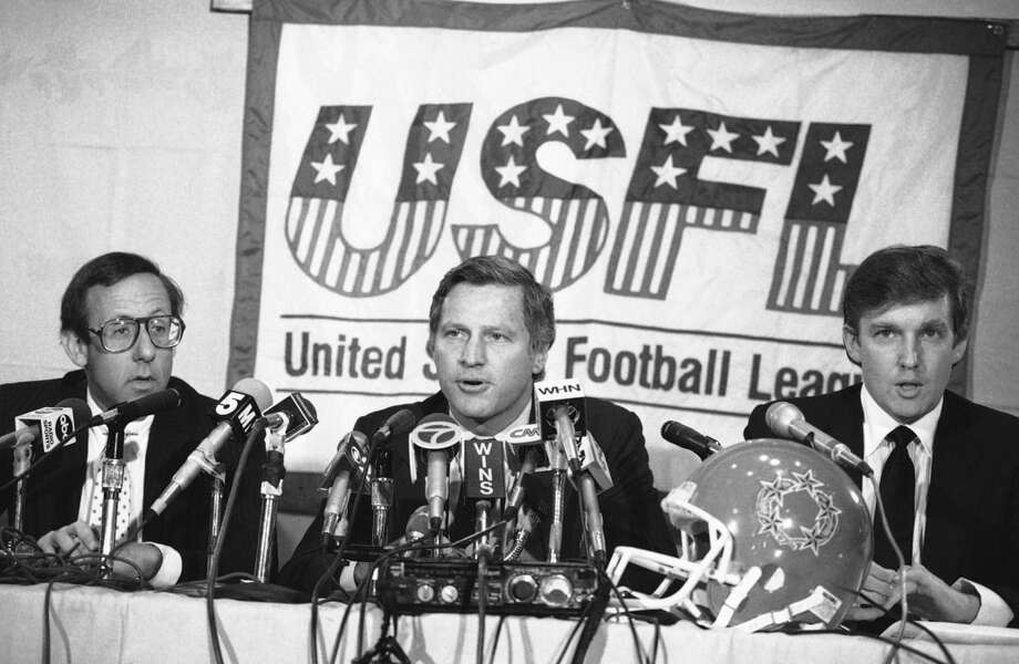 FILE - In this Aug. 2, 1985, file photo, Donald Trump, right, New York real estate magnates Stephen Ross, left, and USFL Commissioner Harry L. Usher, center, participate in a news conference in New York to discuss the agreement they have reached in principle to merge the Houston Gamblers and New Jersey Generals football franchises. The New Jersey Generals have been largely forgotten, but Trump's ownership of the team was formative in his evolution as a public figure and peerless self-publicist. With money and swagger, he led a shaky and relatively low-budget spring football league, the USFL, into a showdown with the NFL. (AP Photo/Marty Lederhandler, File)