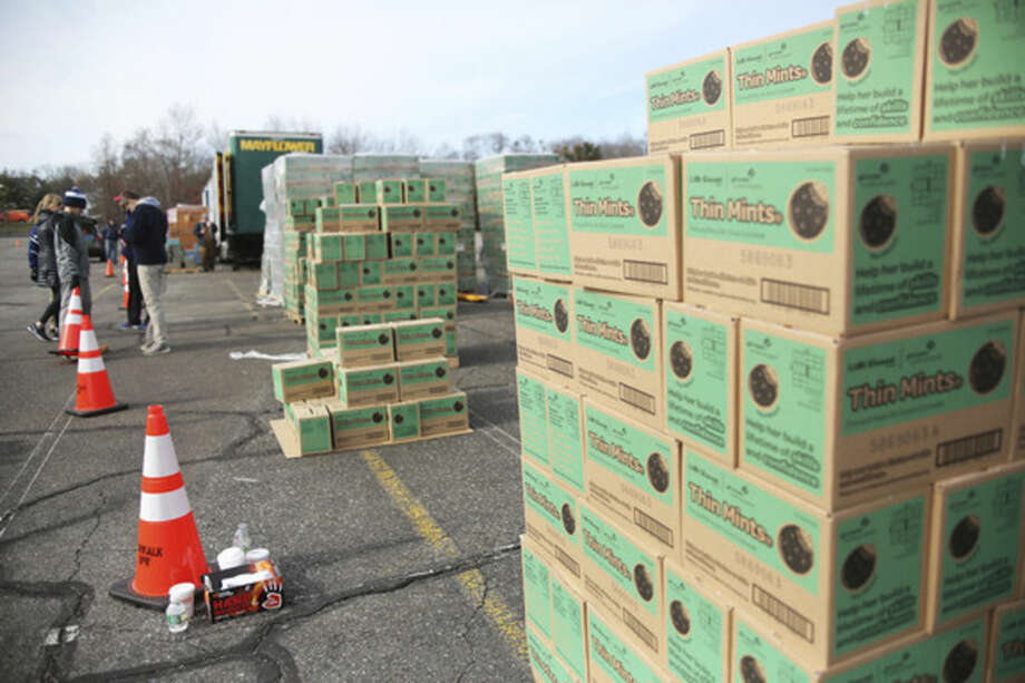 Boxes of Thin Mints wait to be picked up during a state wide cookie drop hosted by Girls Scouts of America at Norden Park in Norwalk Saturday morning.Hour Photo / Danielle Calloway
