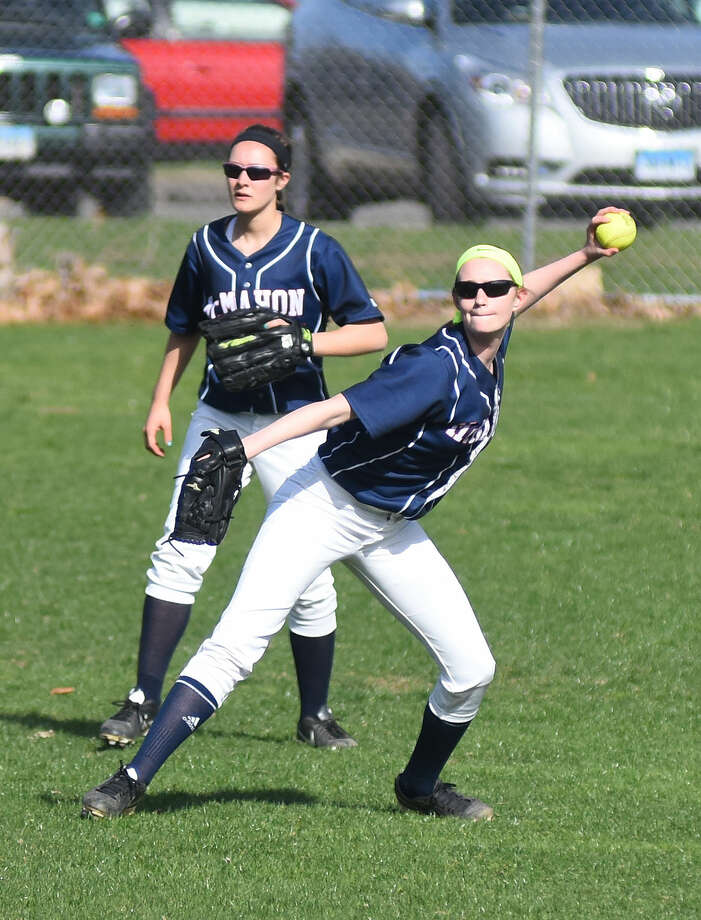 Hour photo/John Nash - Action photos from Thursday's Norwalk vs. McMahon Softball Game. Norwalk won 3-1.