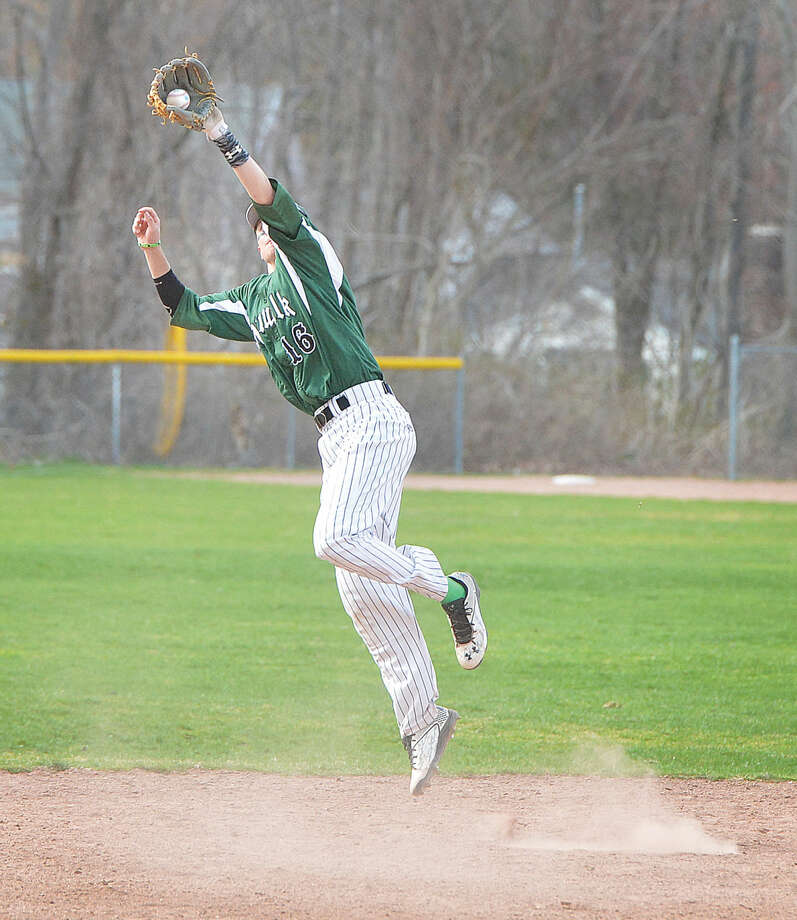 Norwalk's Eddie McCabe jumps to make a catch against Trinity Catholic on Wednesday. (Hour Photo/Alex von Kleydorff)