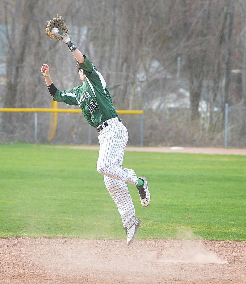 Norwalk's Eddie McCabe jumps to make a catch against Trinity Catholic on Wednesday. (Hour Photo/Alex von Kleydorff)