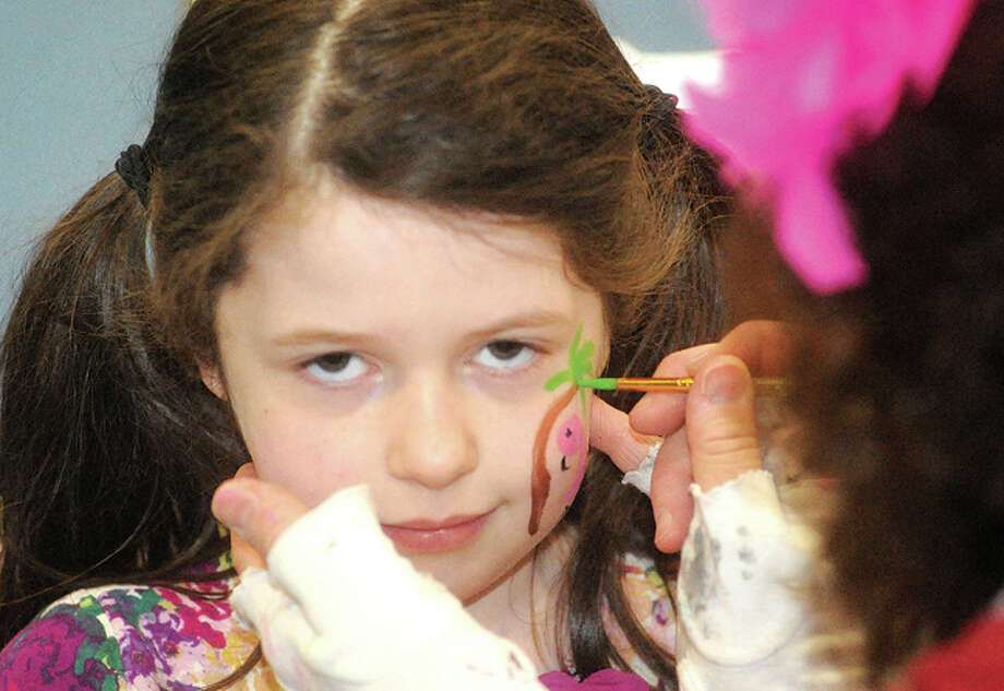 Ainsley Dahlstrom 6, getting the finishing touches of facepaint Sunday at the Kids Fest held in the Wilton High School field house. Hour photo/Matthew Vinci