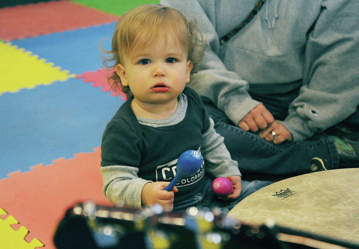 14 month old Everett Nieman gets into the music with Music Together of Fairfield County Sunday at the Kids Fest held in the Wilton High School field house. Hour photo/Matthew Vinci