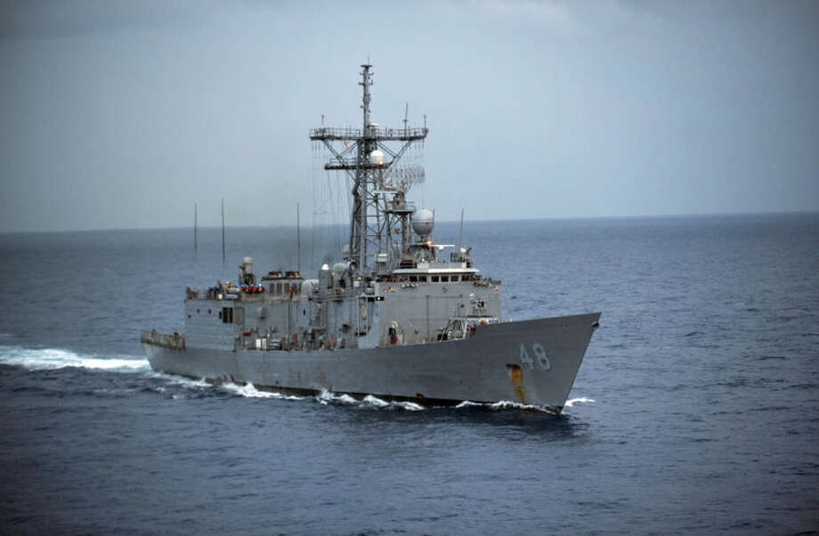 In this image provided by the U.S. Navy the USS Vandegrift is underway Oct. 15, 2012 in the South China Sea. The U.S. Navy warship reached the crippled sailboat hundreds of miles off the Mexican coast and was preparing Sunday April 6, 2014 to complete the rescue of a sick 1-year-old girl. (AP Photo/U.S. Navy, Specialist 3rd Class Paul Kelly)