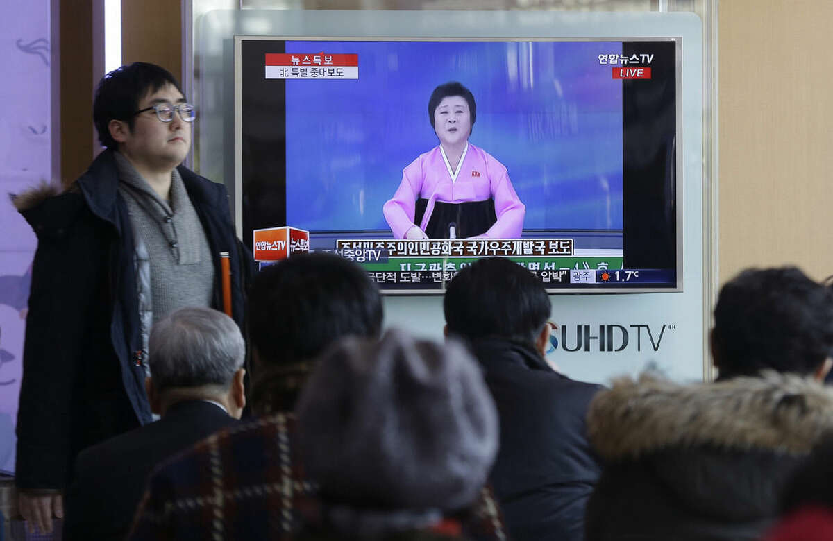 People watch a TV news program showing the North Korea's statement saying it will launch more satellites at Seoul Railway Station in Seoul, South Korea, Sunday, Feb. 7, 2016. North Korea on Sunday defied international warnings and launched a long-range rocket that the United Nations and others call a cover for a banned test of technology for a missile that could strike the U.S. mainland. (AP Photo/Ahn Young-joon)