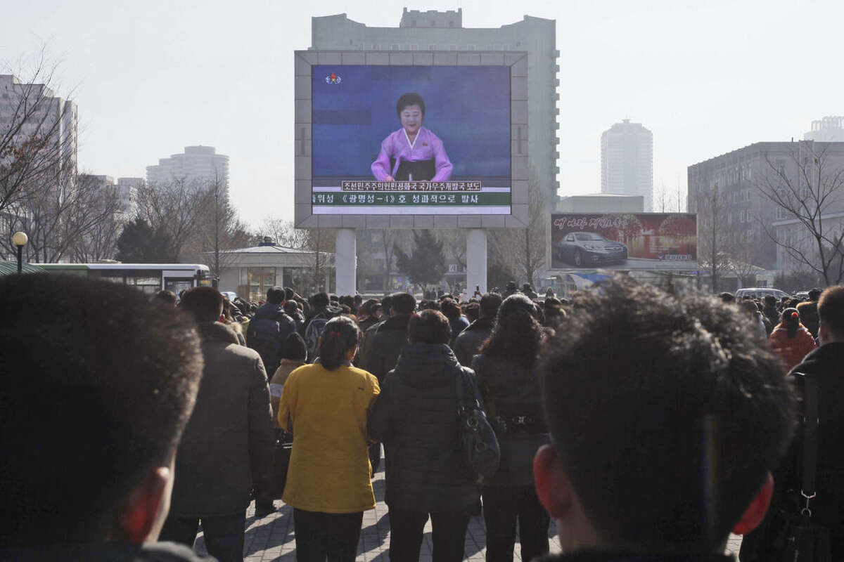 AP Photo/Kim Kwang Hyon North Koreans watch an electronic screen announcing the launch of a satellite on Sunday, Feb. 7, at the Pyongyang Railway Station in Pyongyang, North Korea. North Korea on Sunday defied international warnings and launched a long-range rocket that the United Nations and others call a cover for a banned test of technology for a missile that could strike the U.S. mainland.
