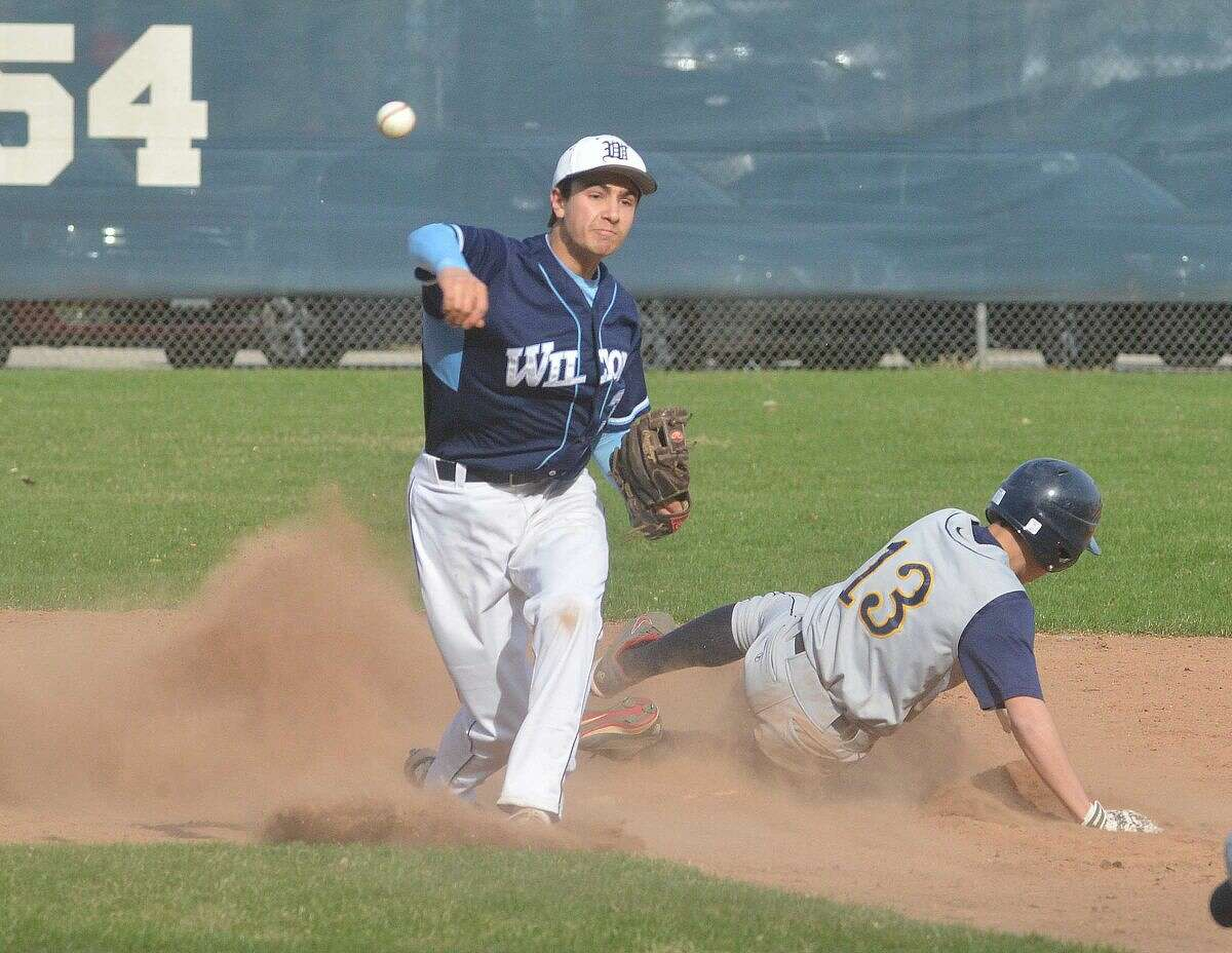 Hour Photo/Alex von Kleydorff Wiltons #31 Dillon Lafari makes the out and the throw to first vs Weston