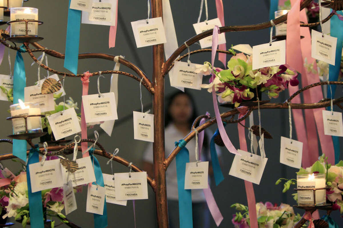 Well-wishes cards for passengers aboard the missing Malaysia Airlines Flight MH370 are tied during a mass prayer for the plane, in Kuala Lumpur, Malaysia, Sunday, April 6, 2014. The head of the multinational search for the missing Malaysia airlines jet said that electronic pulses reportedly picked up by a Chinese ship are an encouraging sign but stresses they are not yet verified. (AP Photo/Lai Seng Sin)